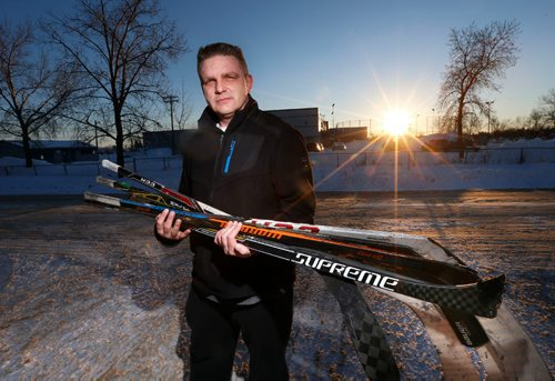 """WAYNE GLOWACKI / WINNIPEG FREE PRESS   Brent Nemeth holds hockey sticks that were left behind after about 20 hockey sticks, most of which were broken were stolen from his garage on Bonner Ave. He is standing at the end of his driveway, in back is the Gateway Recreation Centre.  The family had collected the hockey sticks from friends and teammates of their son, Cooper Nemeth, who was a victim of a homicide earlier this year.¤ The sticks were going to be made into a """"hockey stick bench"""" memorial for Cooper.¤ Courtney Bannatyne story  Dec.29 2016"""