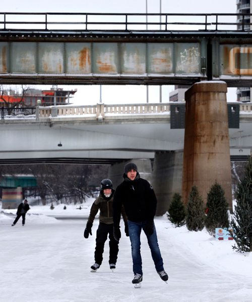 WAYNE GLOWACKI / WINNIPEG FREE PRESS   Aaron Hutton,right, and Rasmus Efraimsson skate on the Assiniboine River, part of the 2km. of the Red River Mutual Trail that opened Monday. The section of the skating trail that opened follows the Assiniboine River from The Forks to the Osborne Bridge and on the Red River to the Norwood Bridge.    Jan.9  2017