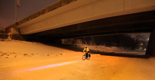 PHIL HOSSACK / WINNIPEG FREE PRESS -  RIVER TRAIL at NIGHT.....A cyclist follows his headlight hi-beam along the trail Monday. Skaters cyclists and walkers started making their appearance Monday night as the Forks River trail opened officially for the season. ....January 9, 2017