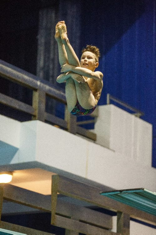 MIKE DEAL / WINNIPEG FREE PRESS Michael Doerr from Thunder Bay, dives off the three meter board during The Polar Bear Classic diving competition at Pan Am Pool Sunday. 170129 - Sunday, January 29, 2017.