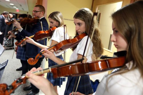 JASON HALSTEAD / WINNIPEG FREE PRESS  From right, Grace Kemerle, Joy Kemerle and Speranza Albensi perform at the St. Mary's Academy Igniting Hope Gala gala on Jan. 28, 2017, at St. Mary's Academy. (See Social Page)