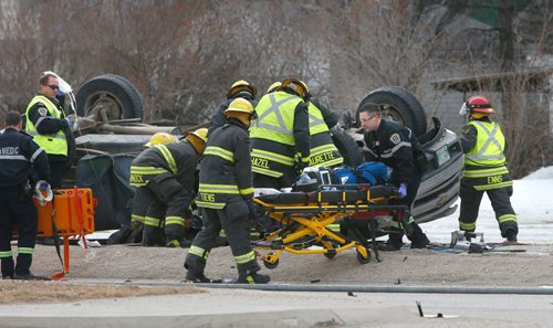 WAYNE GLOWACKI / WINNIPEG FREE PRESS  Emergency personnel at the scene of a two vehicle collision on Grant Ave. at Lilac St. Wednesday morning that has sent at least one person to hospital. The incident has closed Grant Ave. in both directions as police investigate the scene. March 22    2017