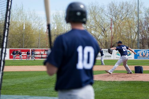 Infielder Wes Darvil (#10) watches as right hand pitcher Ryan Chaffee (#25) winds up on the mound during batting practice at the Winnipeg Goldeyes Open House at Shaw Park. Saturday, May 6, 2017. Copyright Jessica Finn for the Winnipeg Free Press.