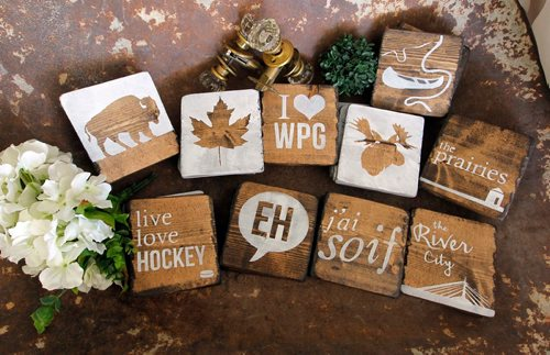 BORIS MINKEVICH / WINNIPEG FREE PRESS INTERSECTION - Julie Carriere's business is called Coco Kisses Designs. Julie makes decorative signs for kitchens and cottages, as well as wedding boards for newly married couples (guests sign the boards), growth charts for kiddies.  These are some coasters she makes that are very popular. DAVE SANDERSON STORY. May 19, 2017