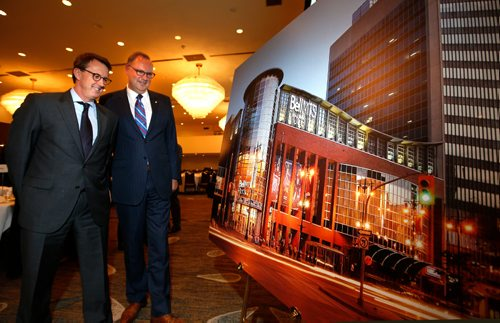 WAYNE GLOWACKI / WINNIPEG FREE PRESS  At right, George Cope, pres. and CEO of Bell Canada and BCE  with Mark Chipman, executive chairman True North Sports+Entertainment with photo rendition of the new renaming signage for the former MTS Centre.  This took place  at the Winnipeg Chamber of Commerce luncheon Tuesday in the Delta Hotel. Martin Cash story  May 30 201