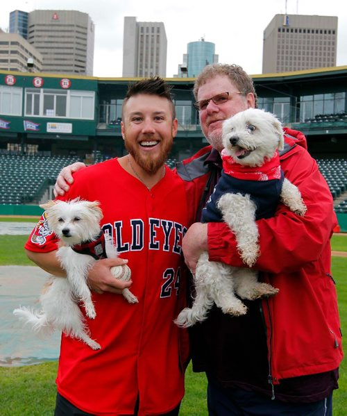 BORIS MINKEVICH / WINNIPEG FREE PRESS Goldeyes at Shaw Park on Saturday are hosting the Bark in the Park game, wherein they are hoping to set a world record for the most dogs at a sporting event. From left, Goldeyes pitcher Edwin Carl holds his dog named Snooks poses with Doug Speirs and his dog Bogey. June 15, 2017