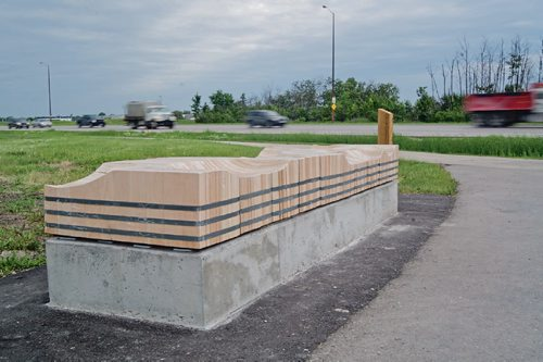 Canstar Community News June 13, 2017 - A new bench designed by Michelle Tustin was installed along the Bishop Grandin Greenway, behind Crampton's Market, on June 10. The bench, titled Potholes, was part of Storefront MB and the Winnipeg Trails Association's BENCHmark competition. (DANIELLE DA SILVA/CANSTAR/SOUWESTER)