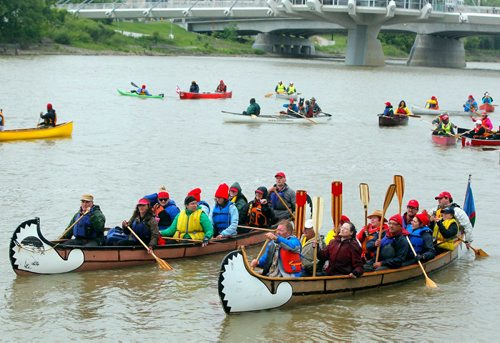 BORIS MINKEVICH / WINNIPEG FREE PRESS Rendez-Vous on the Red - In celebration of the150th anniversary of Canada, voyageurs of La Brigade de la Rivière Rouge, also celebrating its 40th anniversary, recreated the historic paddle along the Red River from St. Jean-Baptiste to The Forks. Many Canoes on the Rouge on the Red River in front of St. Boniface Cathedral. June 24, 2017