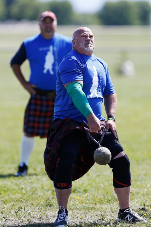 JOHN WOODS / WINNIPEG FREE PRESS Garry MacDonald competes in the Weight Over Bar (WOB) competition in the Scottish Heavy Games at the 51st Manitoba Highland Gathering in Selkirk as John Brown looks on Sunday, June 25, 2017. John Brown won this competition.