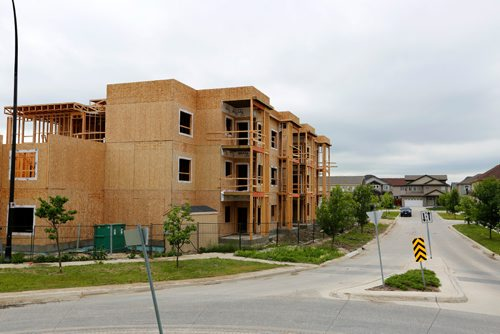 JUSTIN SAMANSKI-LANGILLE / WINNIPEG FREE PRESS A condo building is seen under construction Monday on Ancaster Gate in the Bridgewater Forest housing development in the city's South end. This condo project is just one example showcasing the continued frantic pace of housing construction the city has seen in the first half of 2017. 170711 - Tuesday, July 11, 2017.