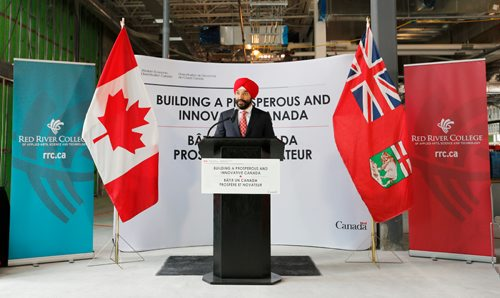 JUSTIN SAMANSKI-LANGILLE / WINNIPEG FREE PRESS Federal Minister of Innovation, Science and Economic Development Navdeep Bains speaks at a press conference Wednesday held in the construction site for Red River College's future Smart Factory. The event was used to announce a combined investment of over $15 million in the project shared between the federal government and StandardAero. 170802 - Wednesday, August 02, 2017.
