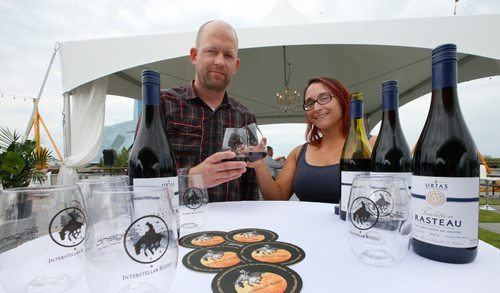 """WAYNE GLOWACKI / WINNIPEG FREE PRESS  Interstellar Rodeo Wine curator Ben MacPhee-Sigurdson beside Kim Bamburak with Kenaston Wine Market who supplies Ortas Tradition Rasteau from France that is paired with Father John Misty for this year's Interstellar Rodeo August 18-20 at The Forks. This wine choice is """"multi-layered, complex but very open and honest like performer Father John Mist."""" At this preview event held on the parkade at The Forks Tuesday provided details of this year's artist-and-wine pairings and food offerings, which include individual artist pairings, new house wines for 2017 and exclusive 'Interstellar Rodeo' food items offered by select vendors. Ben, also the Wine columnist with the Winnipeg Free Press shared some notes at the event on his selection process this year. August 8 2017"""