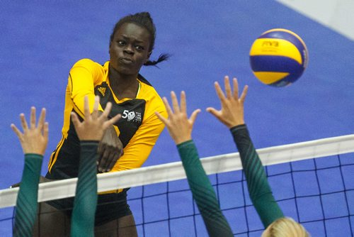 MIKE DEAL / WINNIPEG FREE PRESS Team Manitoba women's volleyball team plays against Team PEI Wednesday afternoon at Investors Group Athletics Centre. Manitoba' Ayiya Ottogo (2) spikes the ball during game action. 170809 - Wednesday, August 09, 2017.