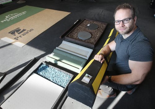 JOE BRYKSA / WINNIPEG FREE PRESSJarrett Wiebe of Reliable Tire Recycling shows products made from recycled tires including a reflective parking curb he is holding.Aug 18, 2017 -( See Murray's  story)