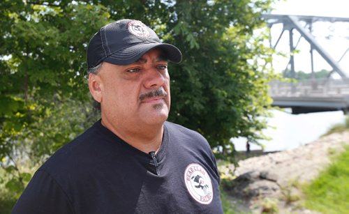 WAYNE GLOWACKI / WINNIPEG FREE PRESS  Bear Clan patrol co-founder James Favel by the Harry Lazarenko Bridge Friday afternoon after a body was recovered and pulled out of the Red River near St. John's Park. August 18 2017