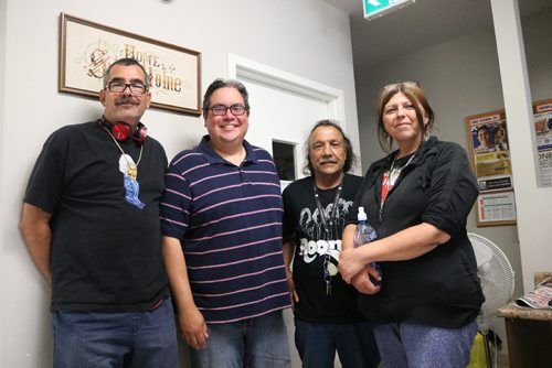 Canstar Community News Aug. 21, 2017 - Kyle Mason (second from left) with regular North End Family Centre members Chris Stunick (far left), Charles Halpin (second right) and Cheryl Houle (far right). (Ligia Braidotti/Canstar Community News/The Times)