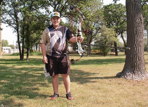 Canstar Community News Austin Taylor, a Grade 12 student at Kildonan East Collegiate, will represent Canada at the upcoming World Youth Archery Championship in Buenos Aires, Argentina. (SHELDON BIRNIE/CANSTAR/THE HERALD)