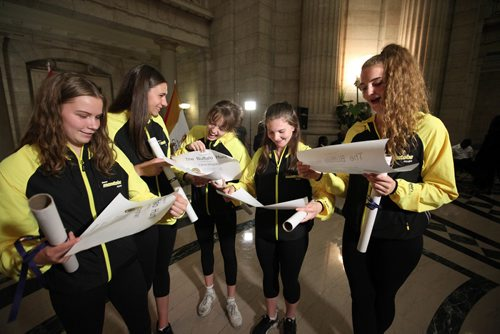 RUTH BONNEVILLE / WINNIPEG FREE PRESS  Some members of the women's 17 and under basketball team open their Order of The Buffalo Hunt certificates given to them by the City of Winnipeg at the Manitoba Legislative Building at a reception for Canada Summer Games medalists Thursday evening.   Names From left to right - Anna Kemaghan, Claire Signatovich,  Lana Shypit, Talia Peters and Emerson Martin.   Premier Brian Pallister and Mayor Brian Bowman congratulated all the medalists at the opening of the event before awards were handed out.    SEPT 14, 2017
