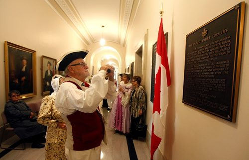 PHIL HOSSACK / WINNIPEG FREE PRESS  -   Ken Swanston photographs a plaque before re-dedication ceremony honoring the United Empire Loyalists. The plaque went missing after some renovations at the Mb Legislature a few years ago and was recently brought back to life. See release.   - Sept 19 2017