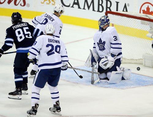TREVOR HAGAN / WINNIPEG FREE PRESS Winnipeg Jets' Mathieu Perreault (85) scores on Toronto Maple Leafs' goaltender Frederik Andersen (31) during third period NHL hockey action on the opening night, Wednesday, October 4, 2017.