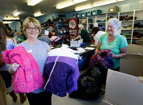 WAYNE GLOWACKI / WINNIPEG FREE PRESS  At left, Donna Albak, Koats for Kids Program Manager and volunteer Joann Selig in the distribution centre Thursday for the launch of the United Way's 2017-18 Koats for Kids Program. Their inventory is low and the need is huge for kids' winter gear.  New and gently used coats, hats, mitts, scarves, boots and skipants for infants and kids can be dropped off at Winnipeg Fire Paramedic Stations and all Perth's Drycleaners locations. United Way's Koats for Kids collects and distributes over 6,000 coats and many thousands of other new and gently-used winter outerwear items donated by generous Winnipeggers each year. Oct.5 2017