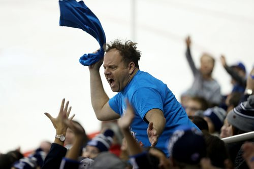 "TREVOR HAGAN / WINNIPEG FREE PRESS Cameron Hughes, self proclaimed ""Professional Crowd Igniter"" throwing t-shirts during a stoppage in play, at the Manitoba Moose vs Cleveland Monsters game, Friday, October 13, 2017."