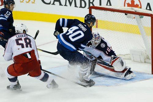 JOHN WOODS / WINNIPEG FREE PRESS Winnipeg Jets' Joel Armia (40) gets the puck past Columbus Blue Jackets goaltender Joonas Korpisalo (70) during third period NHL action in Winnipeg on Tuesday, October 17, 2017.