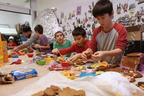 JOHN WOODS / WINNIPEG FREE PRESS Children make haunted gingerbread houses at Art City in Winnipeg Monday, October 23, 2017.