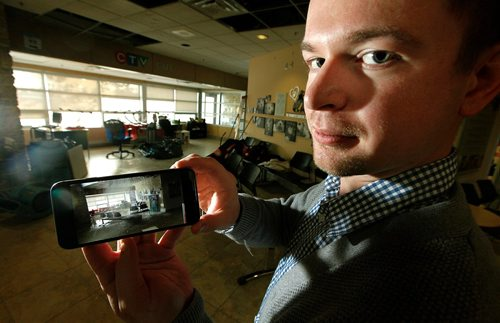 PHIL HOSSACK / WINNIPEG FREE PRESS  - Humane Society's Kyle Jahns shows a video of a waterfall in the reception area (behind him) of the Humane Society facility Monday .The Society will open it's doors again Wednesday after cleaning up the water logged office and reception area....See Alex Paul story.  - November 7, 2017