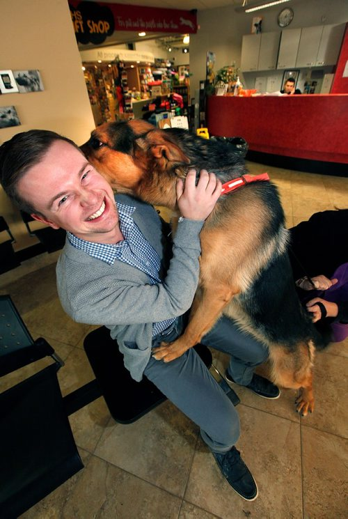 "PHIL HOSSACK / WINNIPEG FREE PRESS  - Humane Society's Kyle Jahns endures the affection of ""King"" a Shepherd cross who was on the operating table when alarms sounded and the Humane Society was evacuated due to a flood Monday. The Society will open it's doors again Wednesday after cleaning up the water logged office and reception area........See Alex Paul story.  - November 7, 2017"