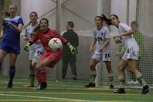 COLIN CORNEAU / WINNIPEG FREE PRESS University of Manitoba Bisons' goalie Justine Jarmoszko looks at a shot on net fly past along with teammates (from left) Shaylyn Dyck, Hayley Ward and Haydn Christensen Burdeny and University of Victoria Vikes' Kiara Kilbey during first half championship match play in the 2017 U Sports Women's Soccer National Championship. November 12, 2017