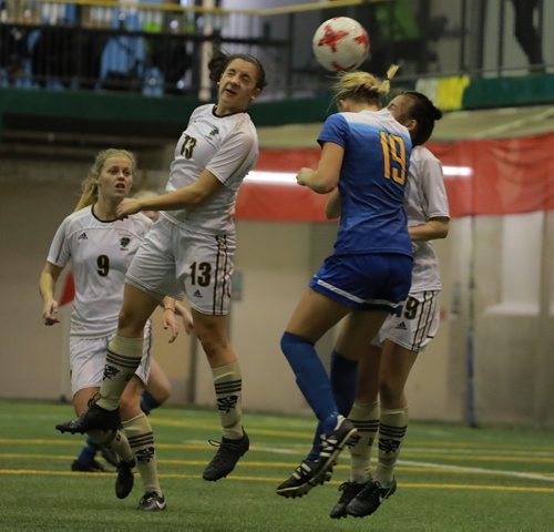 COLIN CORNEAU / WINNIPEG FREE PRESS University of Manitoba Bisons' Chelsea Dubiel heads the ball with University of Victoria Vikes' Rachel Baird as teammates Florin Wagner (left) and Katherine Meo close by during first half championship match play in the 2017 U Sports Women's Soccer National Championship. November 12, 2017
