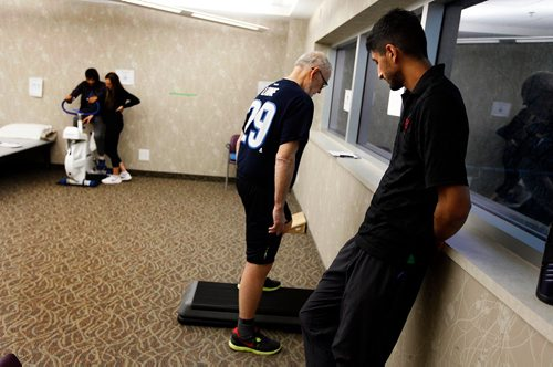 PHIL HOSSACK / WINNIPEG FREE PRESS  - Knee replacement patient Keith Hildahl works the step under the watchfull guidance of Physoitherapist Amandev Dhesi at the Reh-Fit Monday.  See Jane Gerster's story re: Group Physiotherapy.   - November 20, 2017