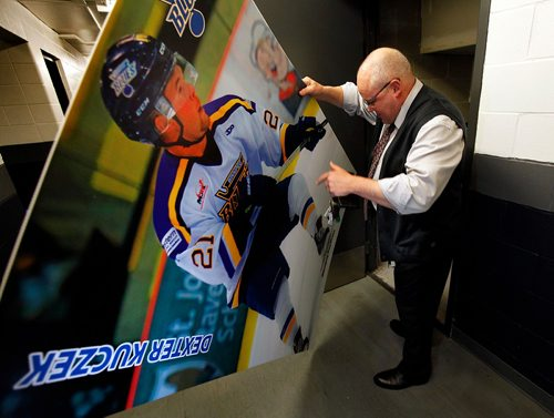 PHIL HOSSACK / WINNIPEG FREE PRESS  -  Winnipeg Blues hockey coach Billy Keane shows off a large portrait of Dexter Kuczek in the hallway at the Iceplex Wednesday before boarding theteam bus to Steinbach for a game. See Mike McIntyre's feature on team travel costs.... - November 22, 2017 ***Dexter is mentioned on the story but was unavailable when the team departed.....they pick him up at Deacon's corner en-route to the game.***
