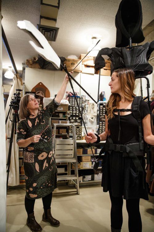 MIKE DEAL / WINNIPEG FREE PRESS Judith Bowden, Costume Designer points with a shoe horn during a discussion about the construction of the Ghost of Christmas Future while actress Lindsay Johnson watches. A behind the scene look of the preparation for the Royal Manitoba Theatre Centre's production of A Christmas Carol. 171108 - Wednesday, November 08, 2017.
