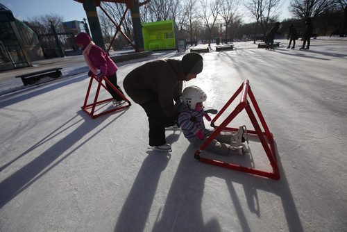 RUTH BONNEVILLE / WINNIPEG FREE PRESS  Maribel Abrenica helps her daughter Miranda (5yrs) skate for the 1st time at the Forks Tuesday.    See extreme cold,  weather story.     Dec 26, 2017
