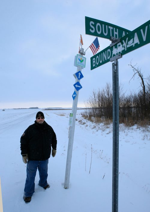 WAYNE GLOWACKI / WINNIPEG FREE PRESS   Doug Johnston, Councillor, Municipality of Emerson-Franklin stands on the Canadian side of Boundary Ave. the international border road at Emerson, Mb. where many border crossers have entered Canada.     Dylan Robertson story   Dec. 28  2017