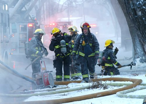 WAYNE GLOWACKI / WINNIPEG FREE PRESS    Winnipeg Fire Fighters battle a three storey rooming house fire Friday morning on Pritchard Ave. The fire in the 200 block of Pritchard Ave. started approximately 7A.M.   Dec. 29  2017