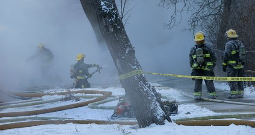 WAYNE GLOWACKI / WINNIPEG FREE PRESS   Winnipeg Fire Fighters battle a house fire in -26C temperatures Friday morning on Pritchard Ave. The fire was in the 200 block of Pritchard Ave., it started approximately 7A.M.   Dec. 29  2017