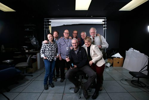 RUTH BONNEVILLE / WINNIPEG FREE PRESS  Winnipeg Free Press Photographer Wayne Glowacki has his photo taken with some of his colleges in the dark room at the Free Press Building on his last day of work Friday.   Dec 29, 2017
