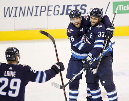 PHIL HOSSACK / Winnipeg Free Press -  Winnipeg Jet #33 Dustin Byfuglien gets a warm welcom back from #26 Blake Wheeler and #29 Patrik Laine early in the first period as Byfuglien opened up the scoring against the Buffalo Sabres with his first goal of the season. -   January 5, 2018