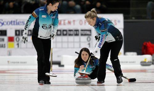 PHIL HOSSACK / Winnipeg Free Press - SCOTTIES - Skip Kerri  Einarson delivers between sweepers Liz Fyfe (left) and Kristin MacCuish Wednesday.  January 10, 2018