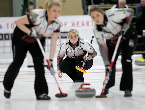 PHIL HOSSACK / Winnipeg Free Press - SCOTTIES - Skip Team Spencer third Katie Spencer delivers betwee sweepers Holly Spencer (left) and Allyson Spencer. January 10, 2018