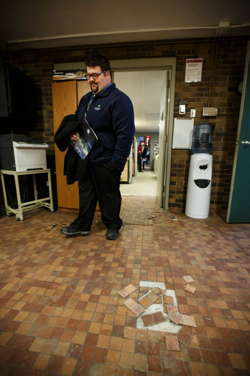 MIKE DEAL / WINNIPEG FREE PRESS The Assiniboine Park Conservancy announced that the Conservatory at Assiniboine Park will permanently close in April 2018. Archie Pronger head of facilities and capital projects walks into a room in the office area of the conservatory where the tile floor started to come apart during the press conference which was held in an adjacent room. 180112 - Friday, January 12, 2018.