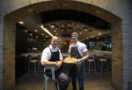 RUTH BONNEVILLE / WINNIPEG FREE PRESS  Restaurant Review. Steffen Zinn (left) and Quin Fergusson (hat) are co-owners of Red Ember, a  neo Neopolitan style pizza restaurant  made with fresh, locally sourced ingredients located at the Forks.    Jan 12, 2018