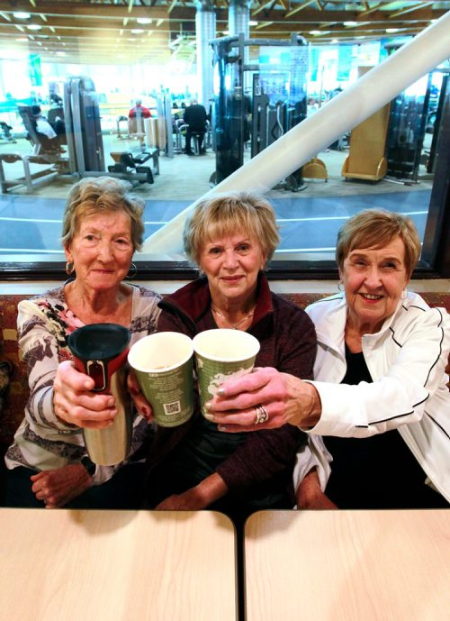 BORIS MINKEVICH / WINNIPEG FREE PRESS From left, Lydia Pronyk, Lynn Turner, and Bertha Hewitt pose for a photo while having coffee at the Seven Oaks Hospital's Wellness Institute. The track/gym in in behind them. This is for a life front on seniors who get benefit from socializing while at the gym. JILL WILSON STORY  Feb. 9, 2018