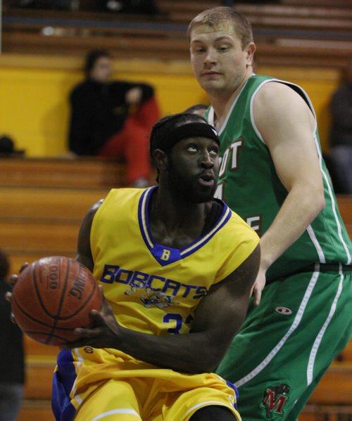 Brandon Sun Brandon University Bobcats' Donovan Gayle drives for the basket as Minot State University Beavers' Mitch Mayer defends, Monday evening. (Colin Corneau/Brandon Sun)