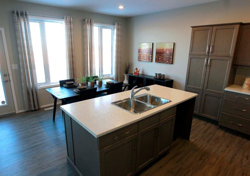 BORIS MINKEVICH / WINNIPEG FREE PRESS NEW HOMES - 139 Castlebury Meadows Drive. Kitchen and island with back eating area. TODD LEWYS STORY  Feb. 12, 2018