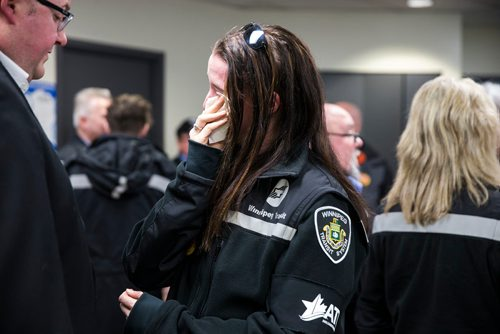 MIKAELA MACKENZIE / WINNIPEG FREE PRESS Crystal Hanley wipes a tear away at a memorial for Irvine Jubal Fraser, an operator killed one year ago, held by the he Amalgamated Transit Union in Winnipeg, Manitoba on Wednesday, Feb. 14, 2018.  180214 - Wednesday, February 14, 2018.