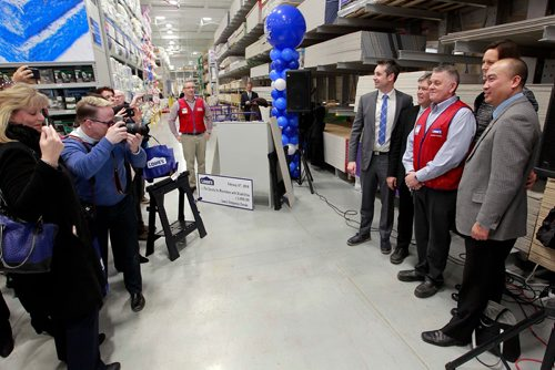 BORIS MINKEVICH / WINNIPEG FREE PRESS Lowe's Canada opened its 64th Lowe's store in Canada, bringing the shopping Lowe's shopping experience to the Winnipeg community at 1799 Kenaston Boulevard. In this photo, middle wearing red vest, Store Manager Ed Golding poses with PC party members and family for a photo. Bill Redekop story. Feb. 15, 2018